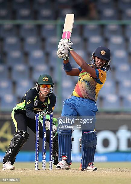 Chamari Atapattu Captain of Sri Lanka hits out with Alyssa Healy of Australia looking on during the Women's ICC World Twenty20 India 2016 match...