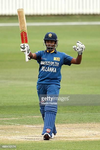Chamari Atapattu of Sri Lanka celebrates her half century during the First Women's One Day International match between New Zealand and Sri Lanka at...
