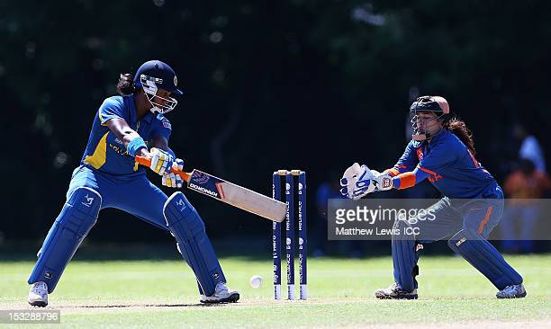 Chamari Atapattu of Sri lanka hits the ball towards the boundaryas Sulakshana Naik of India looks on during the ICC Women's World Twenty20 2012 Play...