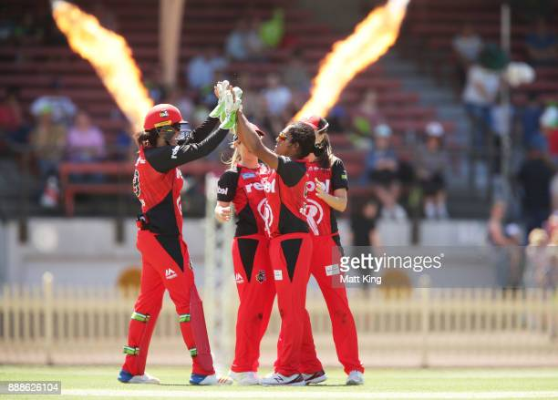 Chamari Atapattu of the Renegades celebrates taking the wicket of Rachel Haynes of the Thunder during the Women's Big Bash League WBBL match between...
