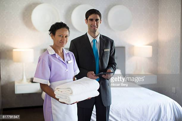 Chambermaid and manager in hotel