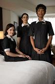 Chambermaids in hotel room, portrait