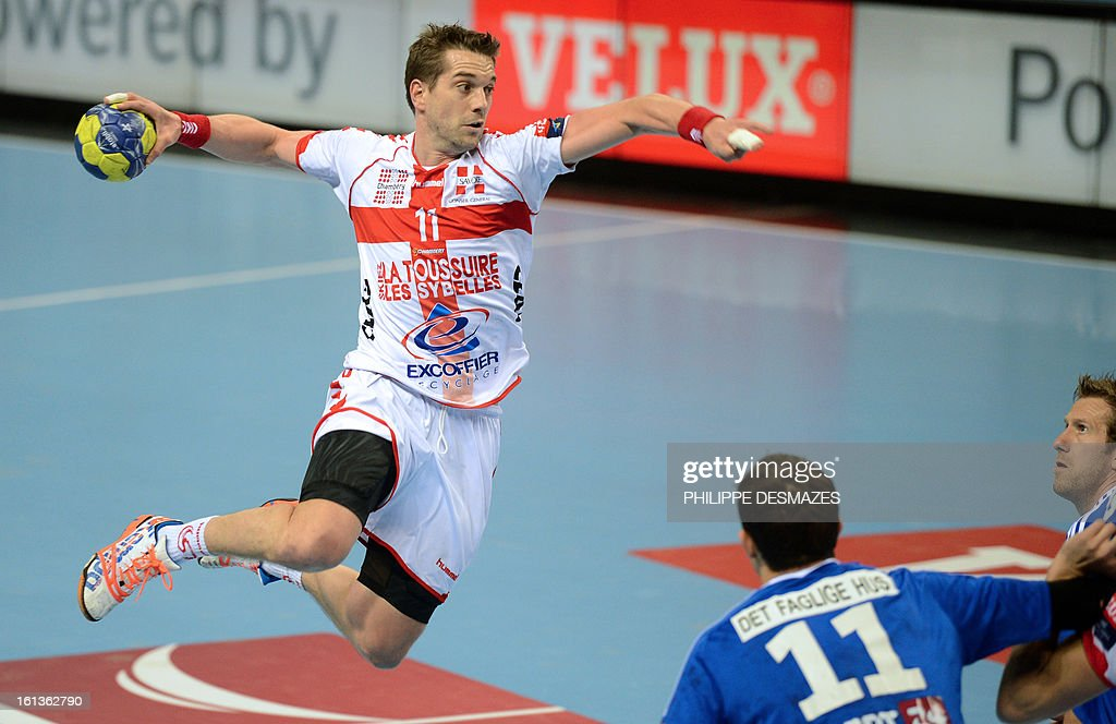 Chambery's Guillaume Gille (L) jumps to shoot against Bjerringbro's Rasmus Lauge (C) and Jannick Green (R) during the Champions League handball match Chambery vs Bjerringbro-Silkenborg on February 10, 2013 in Chambery, eastern France.