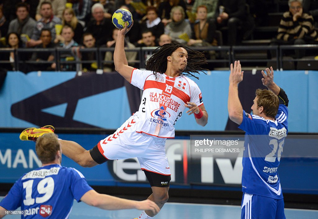 Chambery's Timothey Nguessan (C) jumps to shoot against Bjerringbro's Kasper Nielsen (R) and Henrik Toft (L) during the Champions League handball match Chambery vs Bjerringbro-Silkenborg on February 10, 2013 in Chambery, eastern France. AFP PHOTO/PHILIPPE DESMAZES
