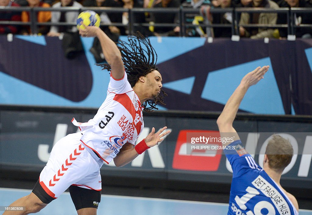 Chambery's Timothey Nguessan (L) jumps to shoot against Bjerringbro's Henrik Toft (R) during the Champions League handball match Chambery vs Bjerringbro-Silkenborg on February 10, 2013 in Chambery, eastern France.