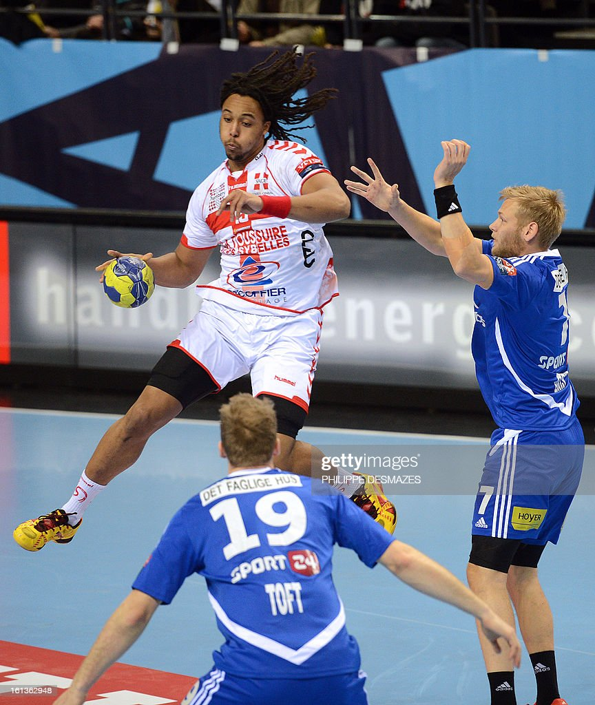 Chambery's Timothey Nguessan (L) jumps to shoot against Bjerringbro's Henrik Toft (C) and Nikolaj Nielsen (R) during the Champions League handball match Chambery vs Bjerringbro-Silkenborg on February 10, 2013 in Chambery, eastern France.