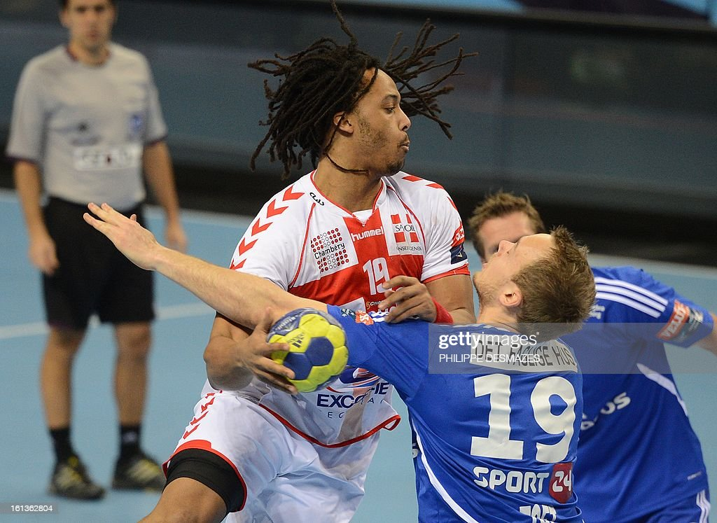 Chambery's Timothey Nguessan (L) vies with Bjerringbro's Henrik Toft (R) during the Champions League handball match Chambery vs Bjerringbro-Silkenborg on February 10, 2013 in Chambery, eastern France.