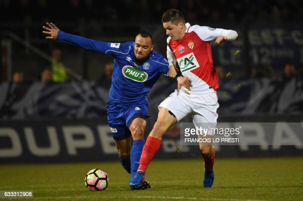 Chambly's Freddy Rocher vies with Monaco's Guido Carrillo during the French Cup football match between Chambly and Monaco on February 1 2017 at...