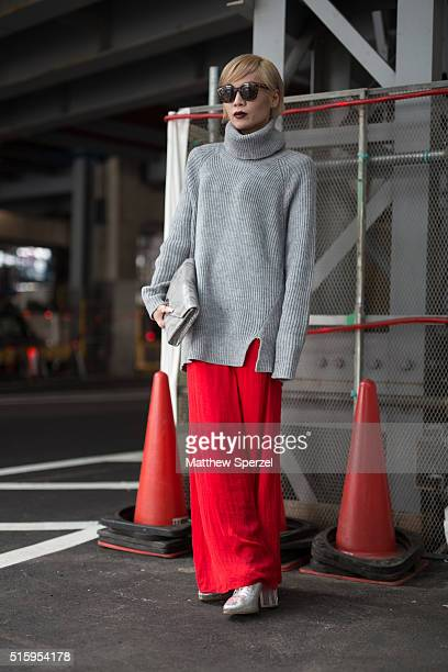 Chamii attends the Anne Sofie Madsen show during Tokyo Fashion Week wearing Emoda glasses Zara bag and pants Topshop sweater and Jeffrey Campbel...