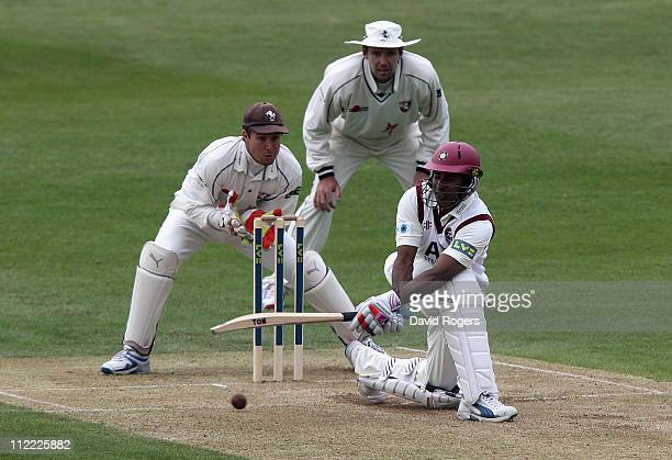 Chaminda Vaas of Northamptonshire sweeps the ball past Kent wicket keeper Geraint Jones during the LV County Championship Division Two match between...
