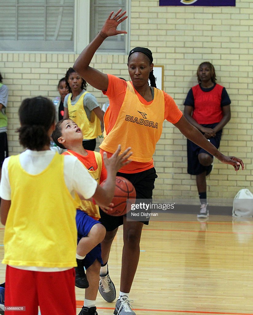 Chamique Holdsclaw defends while playing basketball Senior Administration Officials and Members of Congress hosted a basketball game with Chamique...