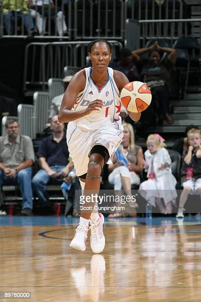 Chamique Holdsclaw of the Atlanta Dream drives the ball up court during the WNBA game against the Phoenix Mercury on July 30 2009 at Philips Arena in...