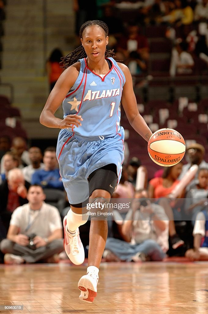 Chamique Holdsclaw of the Atlanta Dream drives the ball up court during the game against the Detroit Shock in Game one of the Eastern Conference...
