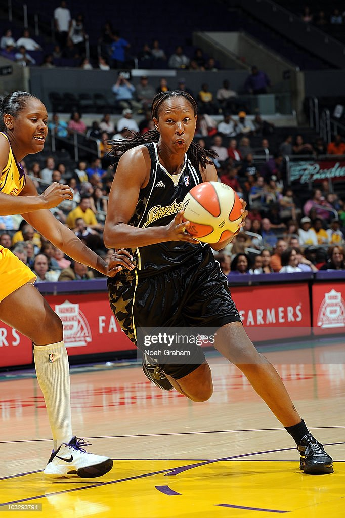 Chamique Holdsclaw of the San Antonio Silver Stars dribbles past Noelle Quinn of the Los Angeles Sparks on August 8 2010 at Staples Center in Los...