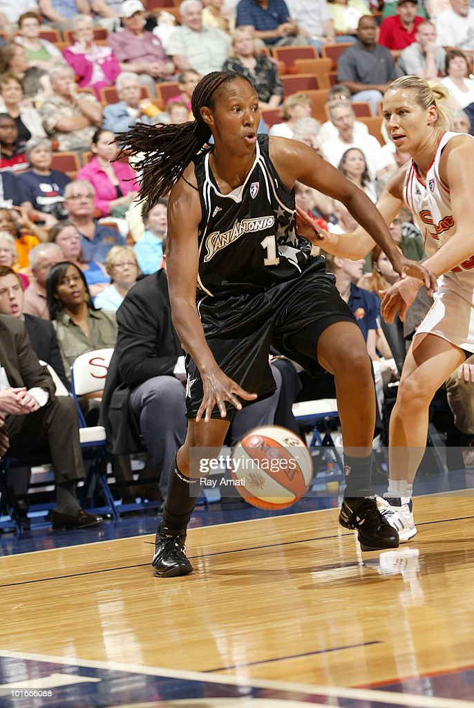 Chamique Holdsclaw of the San Antonio Silver Stars drives against Anete JekabsoneZogota of the Connecticut Sun during the game on June 6 2010 at...