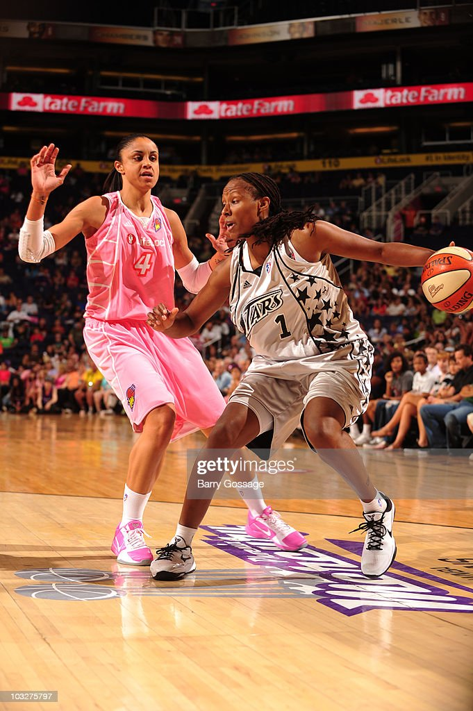 Chamique Holdsclaw of the San Antonio Silver Stars drives against Candice Dupree of the Phoenix Mercury on August 6 2010 at US Airways Center in...