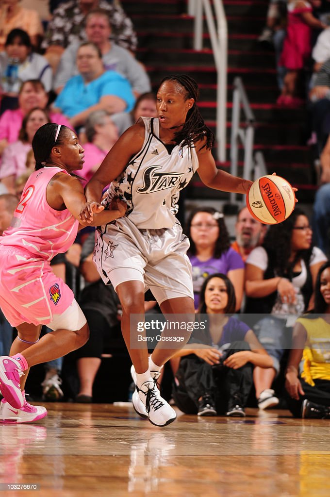 Chamique Holdsclaw of the San Antonio Silver Stars drives against Temeka Johnson of the Phoenix Mercury on August 6 2010 at US Airways Center in...