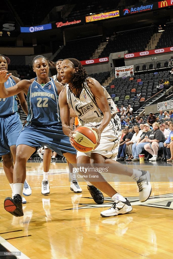 Chamique Holdsclaw of the San Antonio Silver Stars drives to the basket against the Minnesota Lynx during a WNBA game at the ATT Center on August 10...