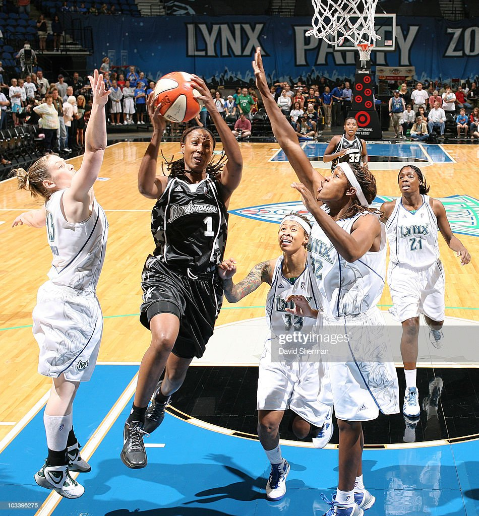 Chamique Holdsclaw of the San Antonio Silver Stars goes up for the layup against Rebekkah Brunson Seimone Augustus and Lindsay Whalen of the...