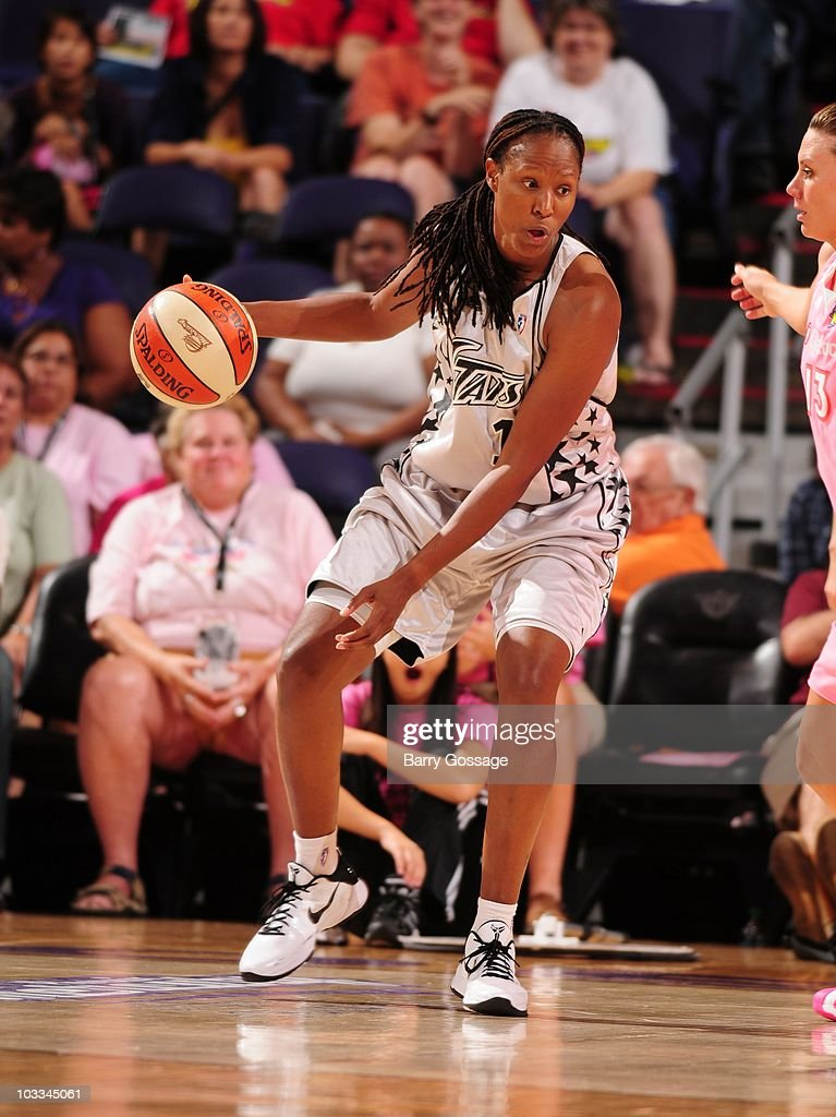 Chamique Holdsclaw of the San Antonio Silver Stars handles the ball during a WNBA game against the Phoenix Mercury on August 6 2010 at US Airways...