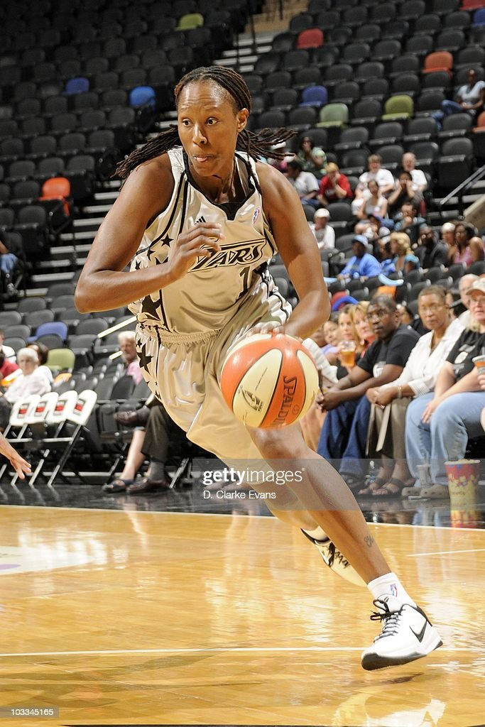 Chamique Holdsclaw of the San Antonio Silver Stars moves the ball moves the ball against the Minnesota Lynx during a WNBA game at the ATT Center on...