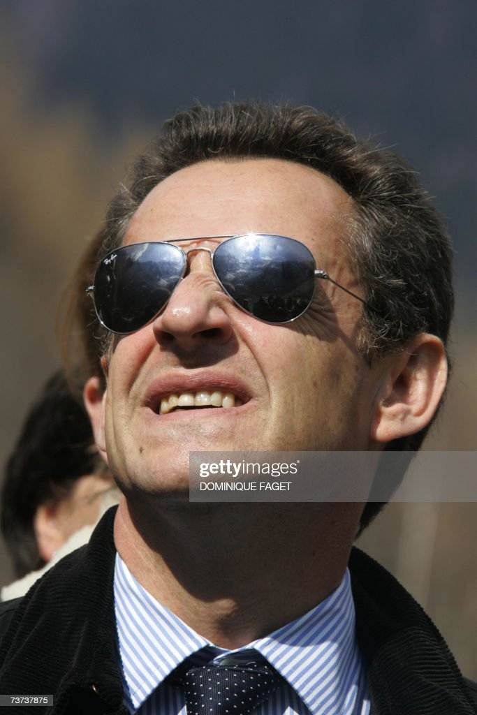 French right-wing official presidential candidate of the ruling Union for a Popular Movement (UMP) Nicolas Sarkozy looks at the sky as he visits the Bossons' glacier near the Mont-Blanc mountain in Chamonix, 29 March 2007 in Chamonix, during a visit in this central eastern French area as part of his campaign. AFP PHOTO DOMINIQUE FAGET