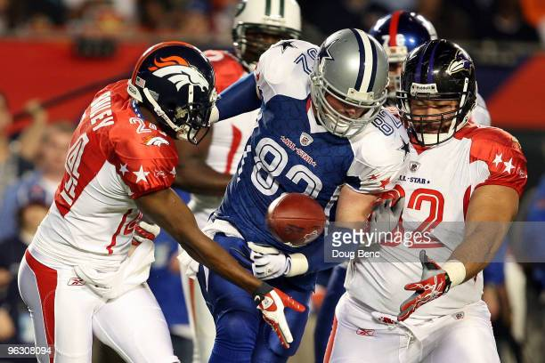 Champ Bailey of the Denver Broncos attempts to lateral the ball to teammates Haloti Ngata of the Baltimore Ravens around Jason Witten of the Dallas...