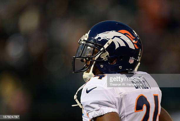 Champ Bailey of the Denver Broncos looks on during pregame warm ups before playing the Oakland Raiders at OaklandAlameda County Coliseum on December...