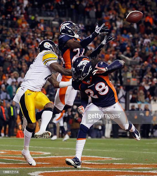 Champ Bailey of the Denver Broncos nearly intercepts a pass intended for Mike Wallace of the Pittsburgh Steelers as Quinton Carter of the Denver...