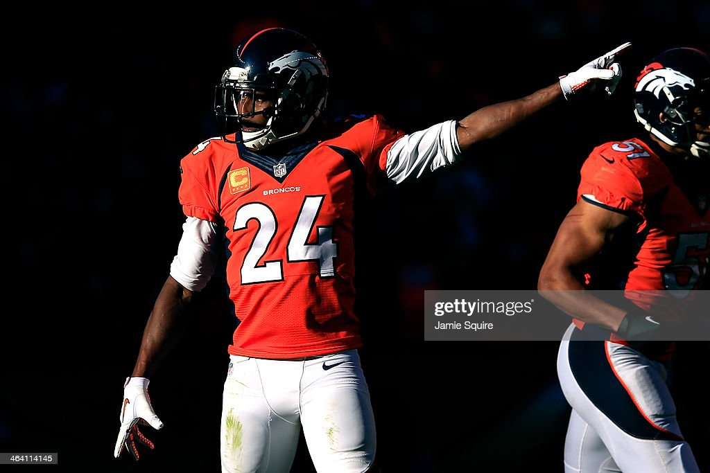 Champ Bailey #24 of the Denver Broncos reacts after a play against the New England Patriots during the AFC Championship game at Sports Authority Field at Mile High on January 19, 2014 in Denver, Colorado.