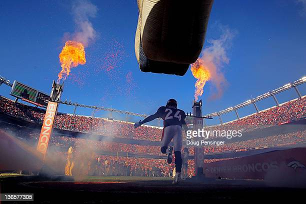 Champ Bailey of the Denver Broncos runs on to the field prior to the AFC Wild Card Playoff game against the Pittsburgh Steelers at Sports Authority...