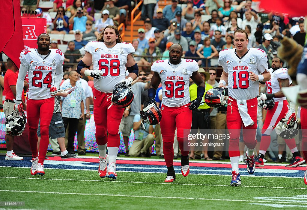 Champ Bailey #24, Zane Beadles #68, Elvis Dumervil #92, and Peyton Manning #18 of the Denver Broncos and the AFC are introduced before the 2013 Pro Bowl against the National Football Conference team at Aloha Stadium on January 27, 2013 in Honolulu, Hawaii