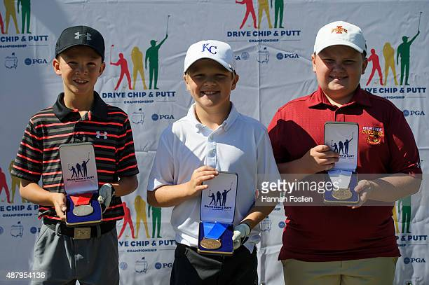 Champ Hettich second place JP Hepler first place and Evan Smith third place pose for a photo after the Regional Finals in the putt for 1011 year old...