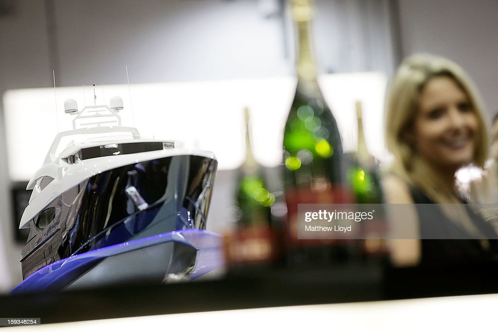 Champagne and a model boat decorate the Sunseeker bar at the 2013 London Boat Show, held at the eXcel centre, on January 12, 2013 in London, England. Until the 20th of January the London Boat Show will showcase, demonstrate and sell maritime equipment ranging from luxury yachts to dinghies.