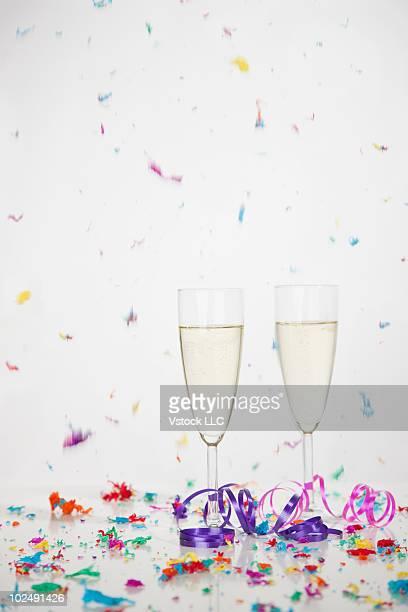 Champagne and colorful confetti