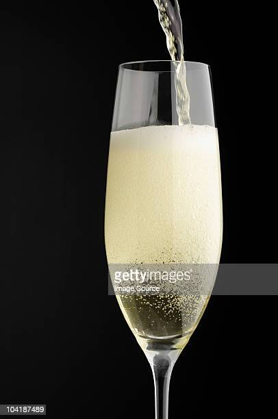 Champagne being poured into champagne glass