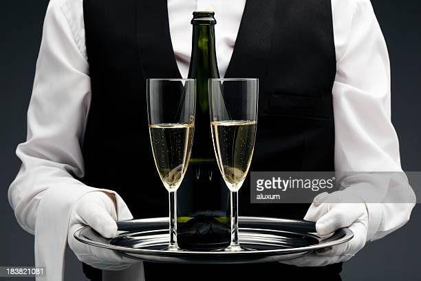 Champagne being served by a waiter