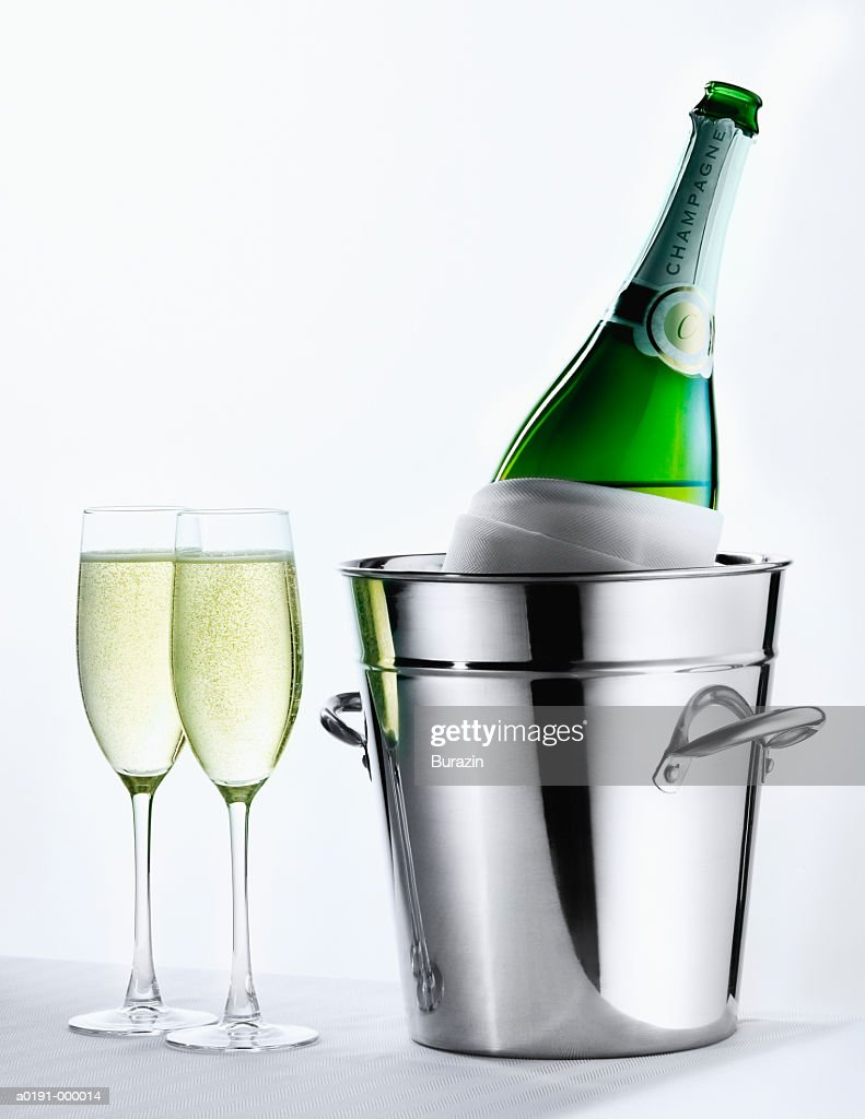 Champagne Bottle and Flutes : Stock Photo