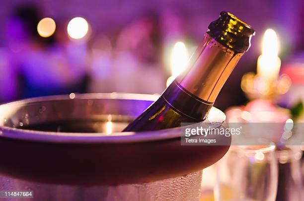 Champagne bottle cooling in ice bucket