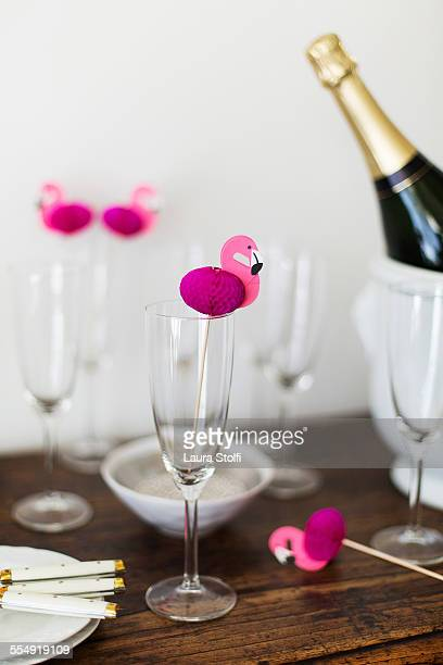Champagne bottle, flutes and pink flamingos