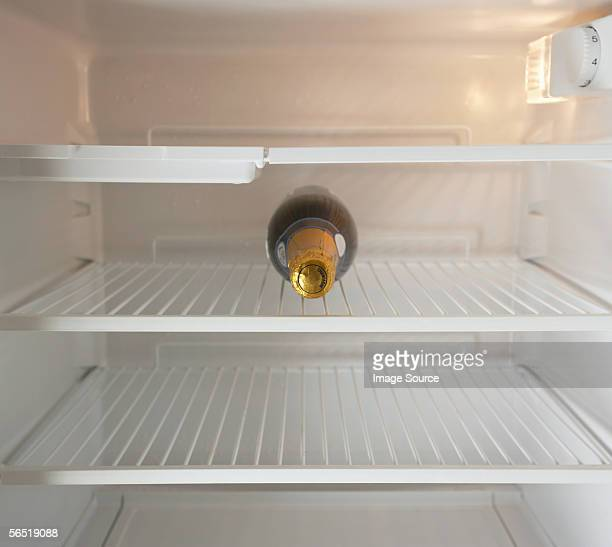 Champagne bottle in a refrigerator