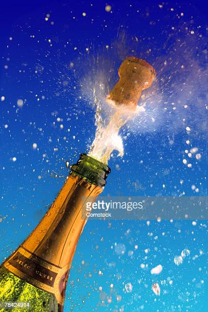 Champagne bottle with popping cork