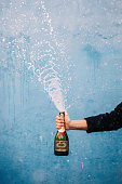 Champagne bottle splashes with sign: Save Water drink champagne