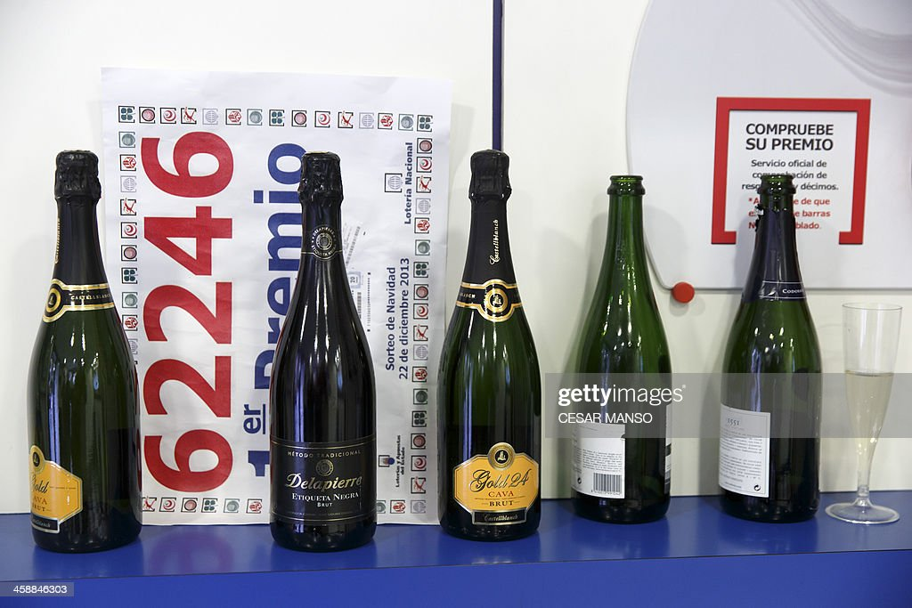 Champagne bottles line a shelf inside a lottery administration shop where a first prize ticket in Spain's Christmas lottery named 'El Gordo' (Fat One) was purchased in Palencia on December 22, 2013. This year's winning number is 62246 presenting winnings of 4 million euros.