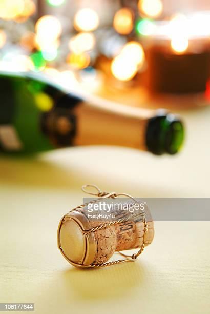 Bouchon de Champagne avec bouteille en arrière-plan
