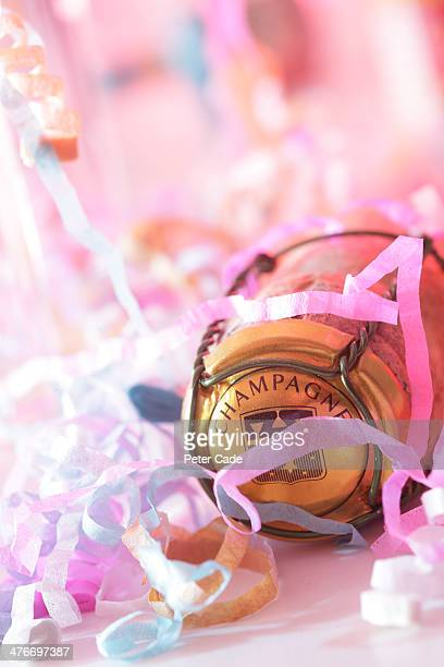 Champagne cork with party streamers