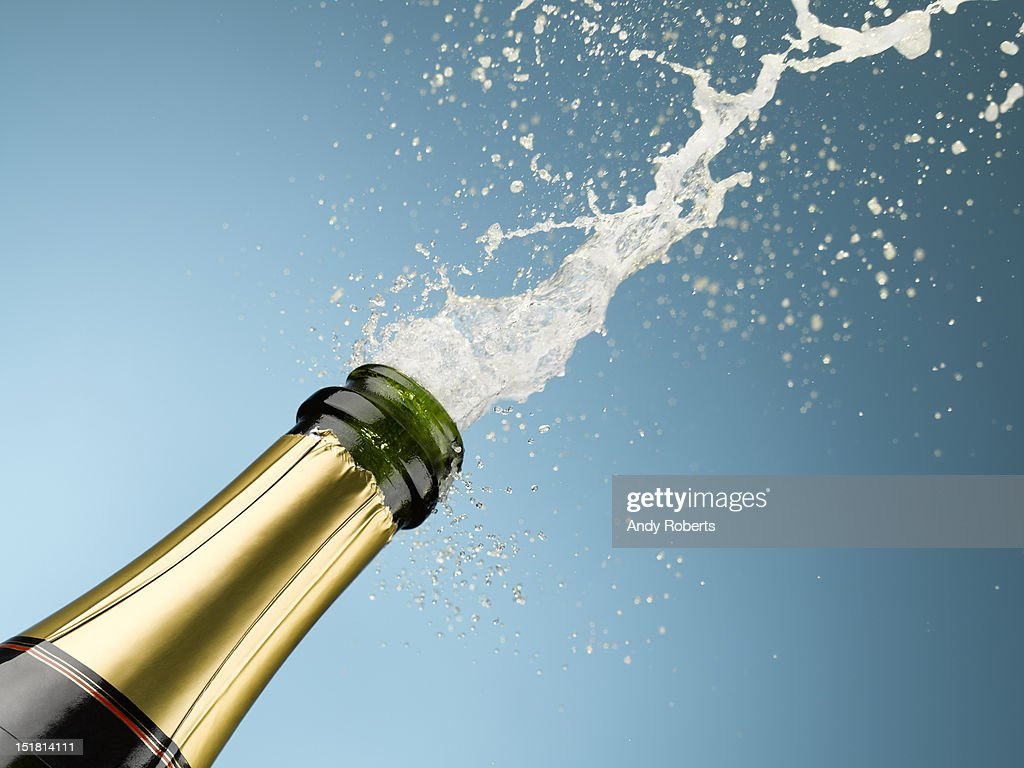 Champagne exploding from bottle : Stock Photo