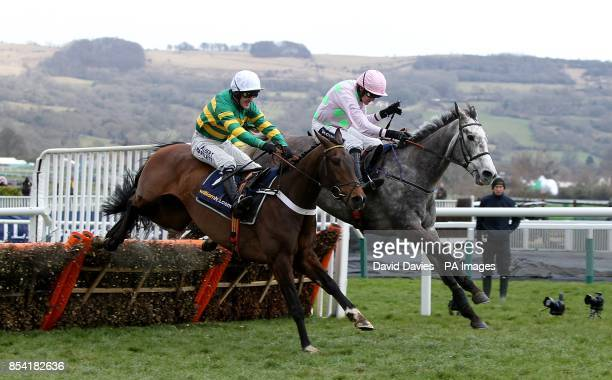 Champagne Fever ridden by Ruby Walsh jumps the last alongside My Tent Or Yours ridden by Tony McCoy and goes on to win the William Hill Supreme...