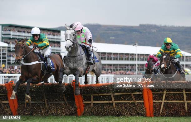 Champagne Fever ridden by Ruby Walsh jumps the last fence alongside My Tent Or Yours ridden by Tony McCoy and goes on to win the William Hill Supreme...