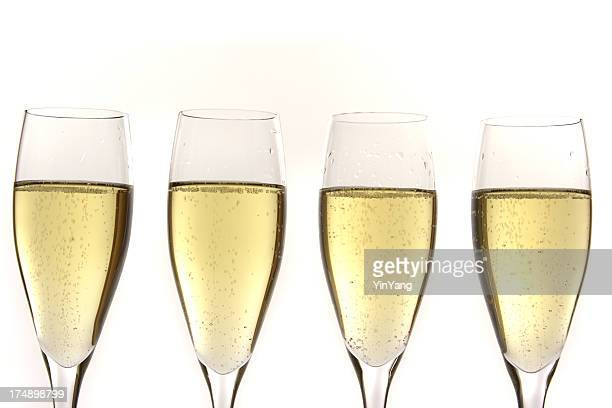 Champagne Flutes, Four Glasses of Bubbly Alcoholic Beverage for Celebrations